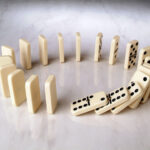 51648948 - row of dominoes in a circle shape on a neutral background